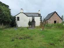 A detached Victorian farmhouse with far reaching rural views and approximately nine acres of grounds...